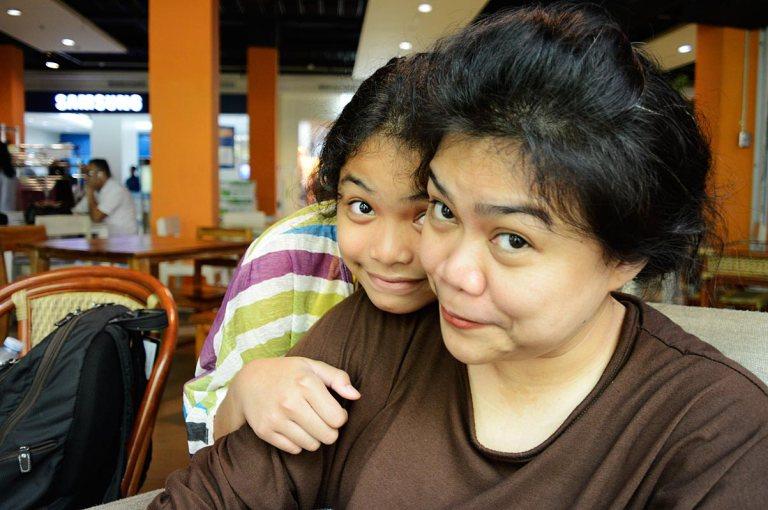 diah dextra daughter mother smile fun cafe girls travel indonesia