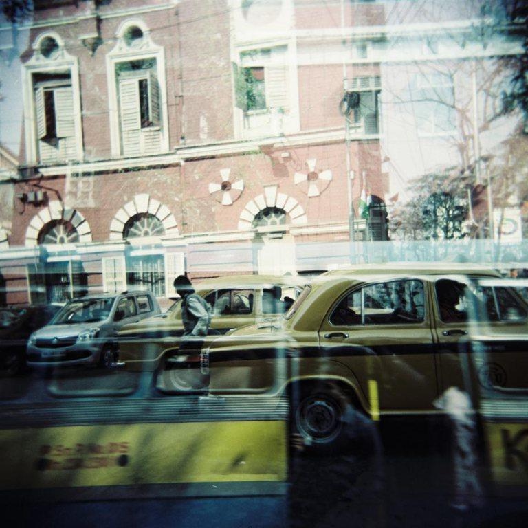 yellow-cab-taxi-kolkata-street-travel-peolple-sky-india-holga-lomography-double-exposure-travel-best-kodak-ektacolor